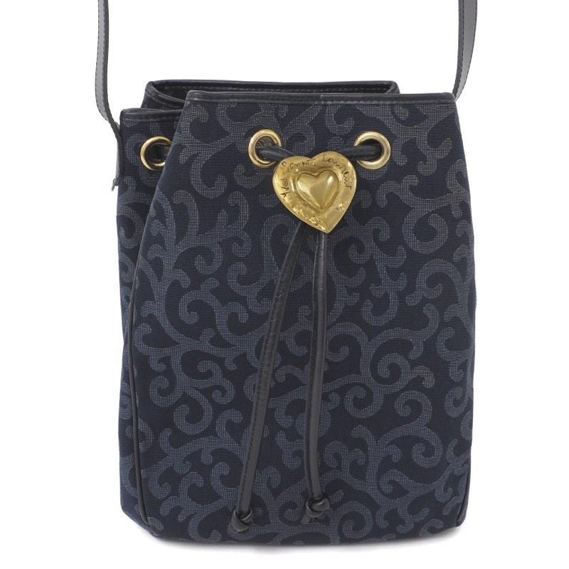 db3aa266b117 Vintage Yves Saint Laurent Arabesque Canvas Heart Logo Drawstring Shoulder  Bag