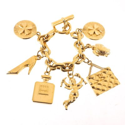 Vintage Chanel Gold 7 Icon Dangling Charm Bangle Bracelet
