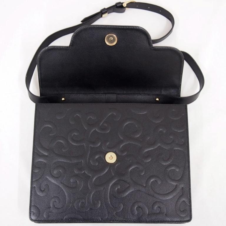 ysl black leather arabesque handbag